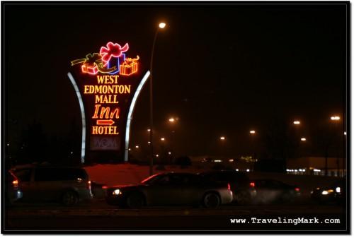 Photo: Sign on the Corner Marking West Edmonton Mall at Night