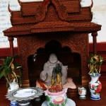 Small Buddha Statue Located at the Rear of the Wat Preah Prom Rath Temple