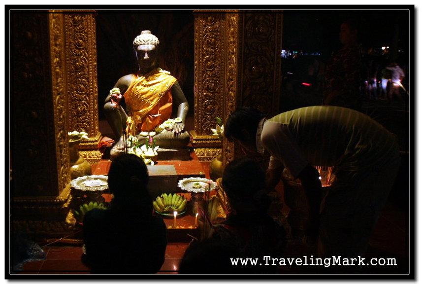 Fruit, Flowers and Burning Incense Sticks Accompany the Prayers of Buddhist Cambodians