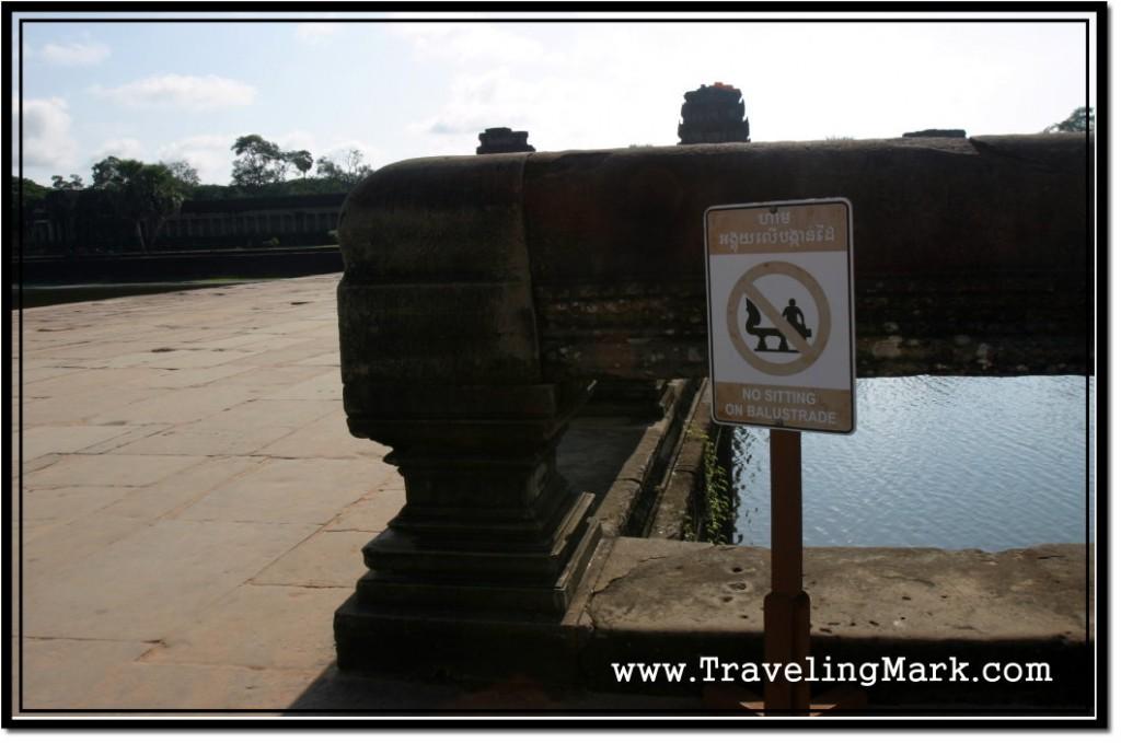Photo: No Sitting on Balustrade - a Sign Warns