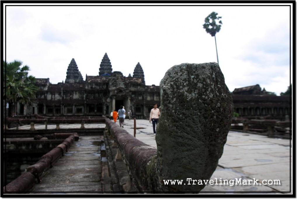 Photo: Damaged Naga at the End of Balustrade Lining Up the Causeway to Angkor Wat