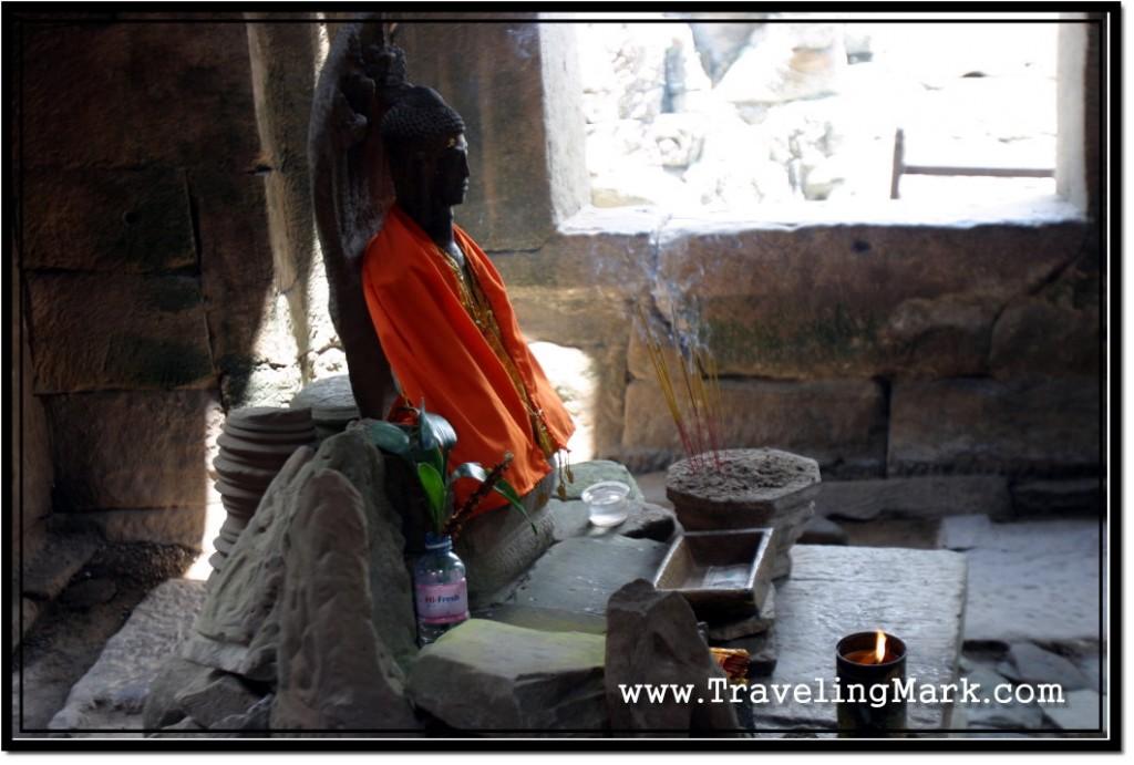 Photo: Insence Stick Burning Before the Image of Buddha at Bayon Temple