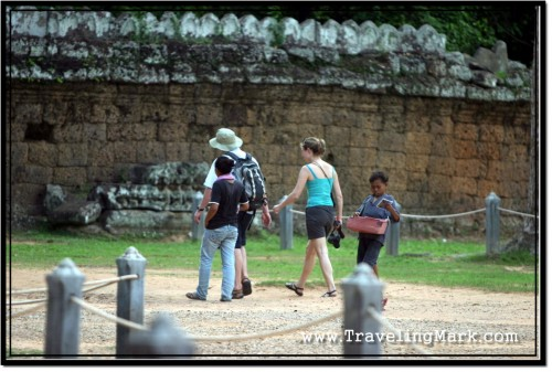 Photo: Touts Pestering Tourists at One of Angkor Archaeological Park Temples