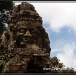 Photo: Faces of Lokeshvara Surmounted Atop the Gate to Banteay Srei