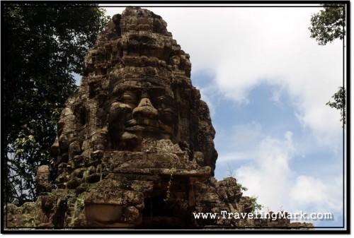 Photo: Faces of Lokeshvara Surmounted Atop the Gate to Banteay Srei