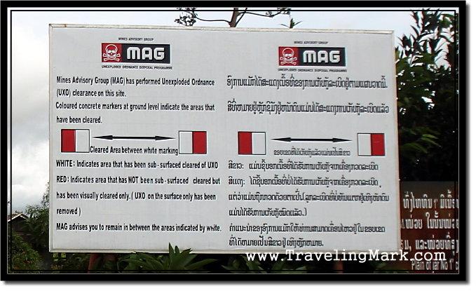 Photo: UXO Warning by Mines Advisory Groups at Plane of Jars, Xieng Khouang Province, Laos