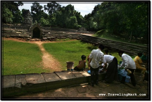 Photo: Cambodian Family Having a Picnic at the Dry Connected Pool of Neak Pean