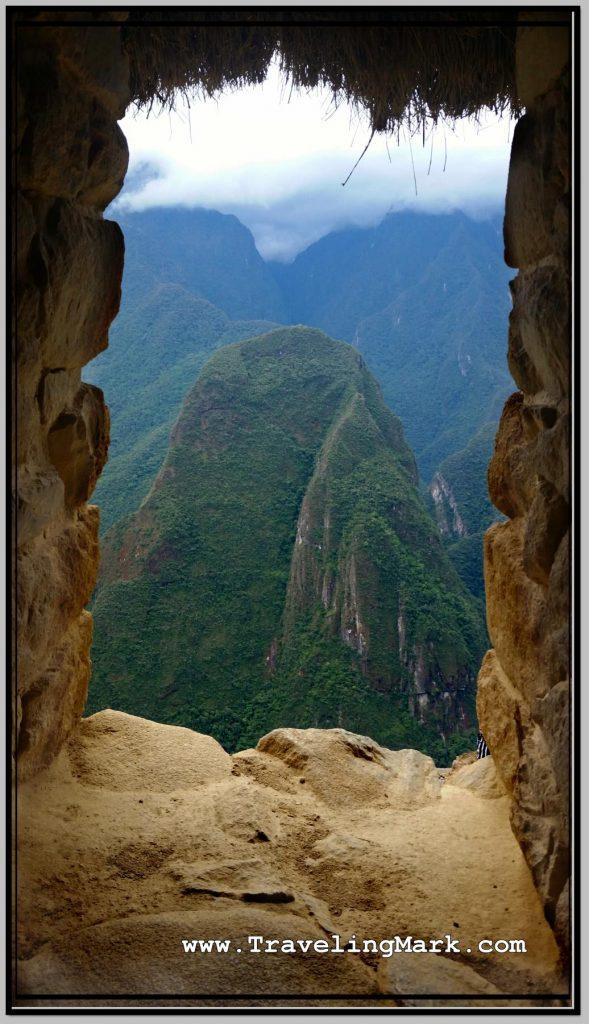 Photo: View of Mountains Surrounding Machu Picchu Through Window of Guard House